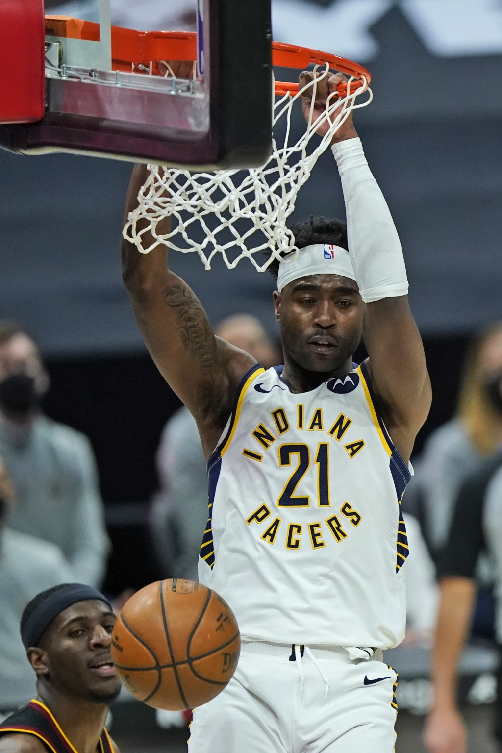 Indiana Pacers' Kelan Martin (21) dunks the ball in the second half of an NBA basketball game against the Cleveland Cavaliers, Monday, May 10, 2021, i...