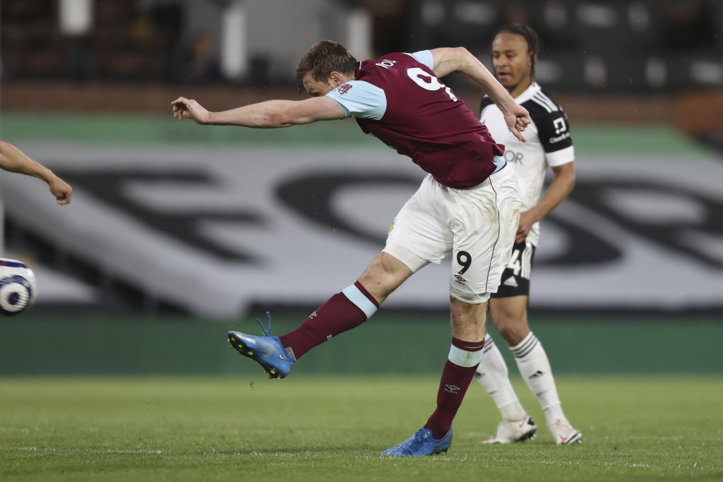 Burnley's Chris Wood, left, scores his side's second goal during the English Premier League soccer match between Fulham and Burnley at the Craven Cott...