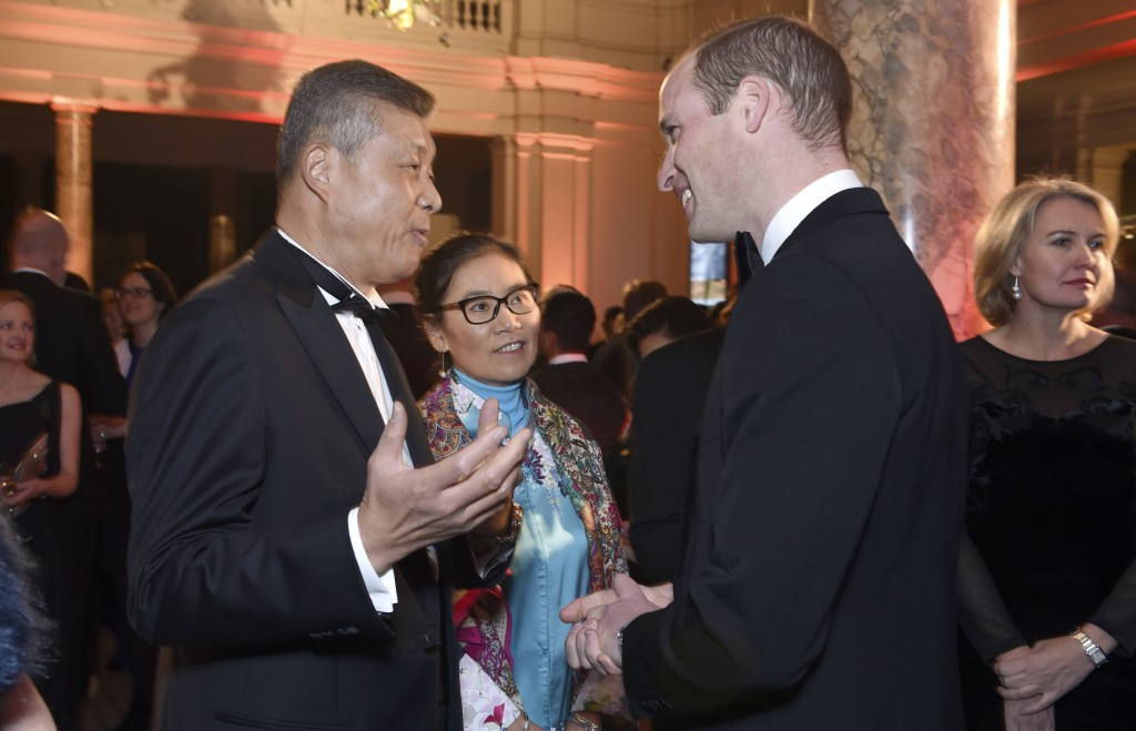 FILE - In this Nov. 30, 2016 file photo, Chinese Ambassador to the United Kingdom, Liu Xiaoming, left, speaks with Britain's Prince William, Duke of C...