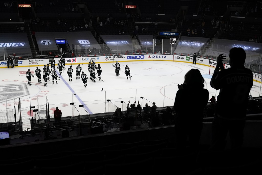 Fans applaud as the Los Angeles Kings leave the ice after they lost their hockey game 2-1 against the St. Louis Blues Monday, May 10, 2021, in Los Ang...