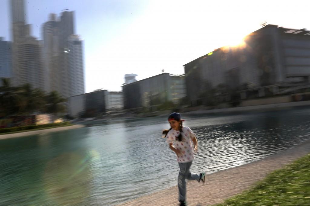 Michelle Rasul enjoys a run along a lake in Dubai, United Arab Emirates, Sunday, May 9, 2021. Rasul, a 9-year-old girl from Azerbaijan who lives in Du...