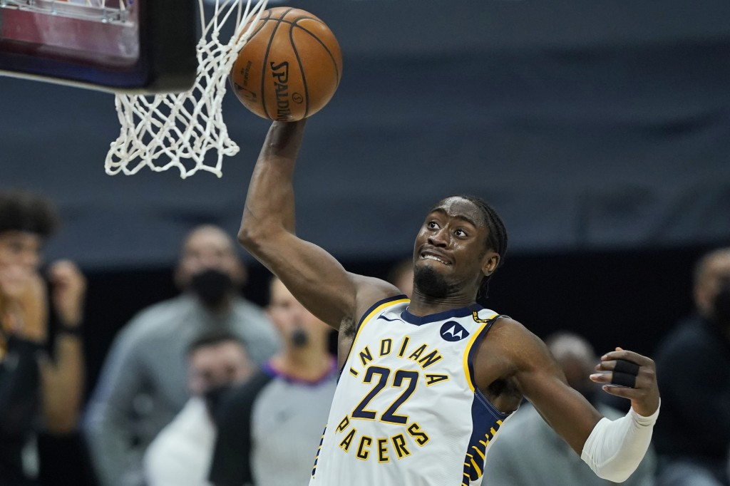 Indiana Pacers' Caris LeVert dunks the ball in the second half of an NBA basketball game against the Cleveland Cavaliers, Monday, May 10, 2021, in Cle...