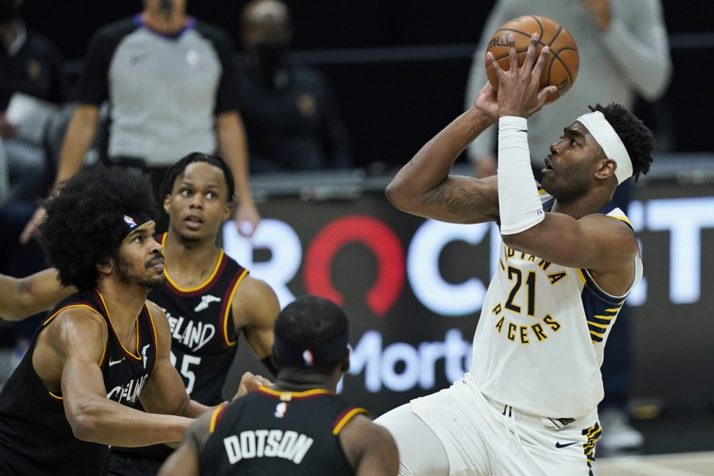 Indiana Pacers' Kelan Martin (21) shoots against the Cleveland Cavaliers in the second half of an NBA basketball game, Monday, May 10, 2021, in Clevel...