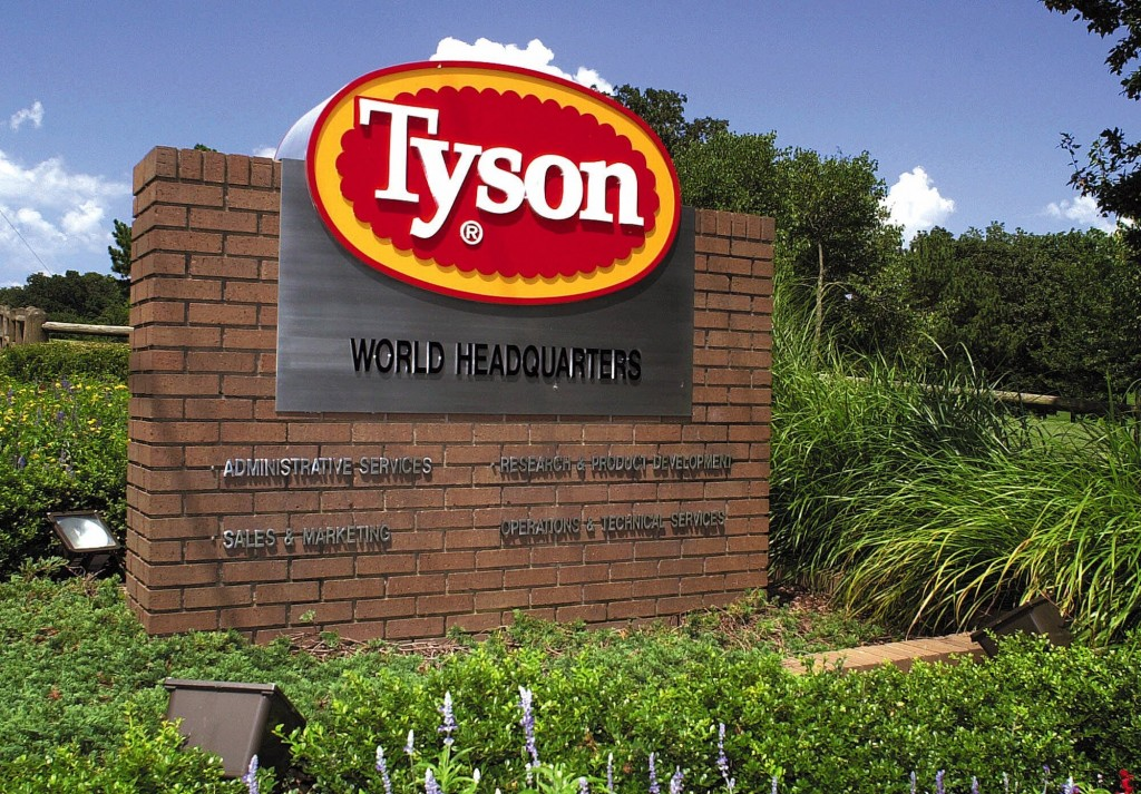 FILE - In this July 30, 2001, file photo, a sign marks the entrance to Tyson Foods headquarters in Springdale, Ark. Tyson Foods says it is raising wag...