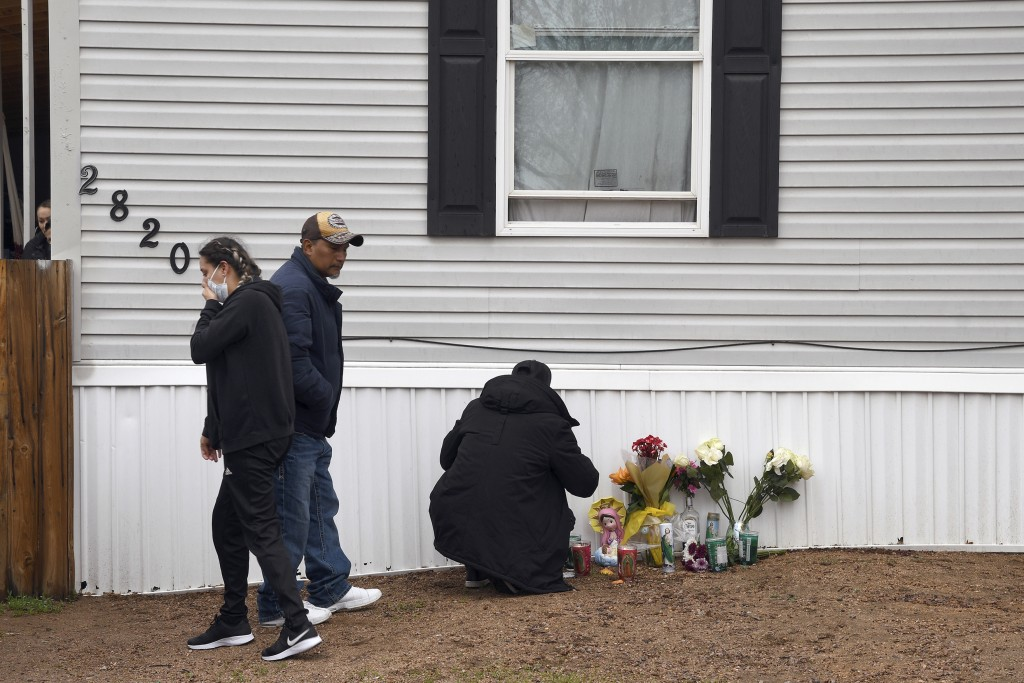 Mourners organize a memorial on Monday, May 10, 2021, outside a mobile home in Colorado Springs, Colo., where a shooting at a party Sunday took place....