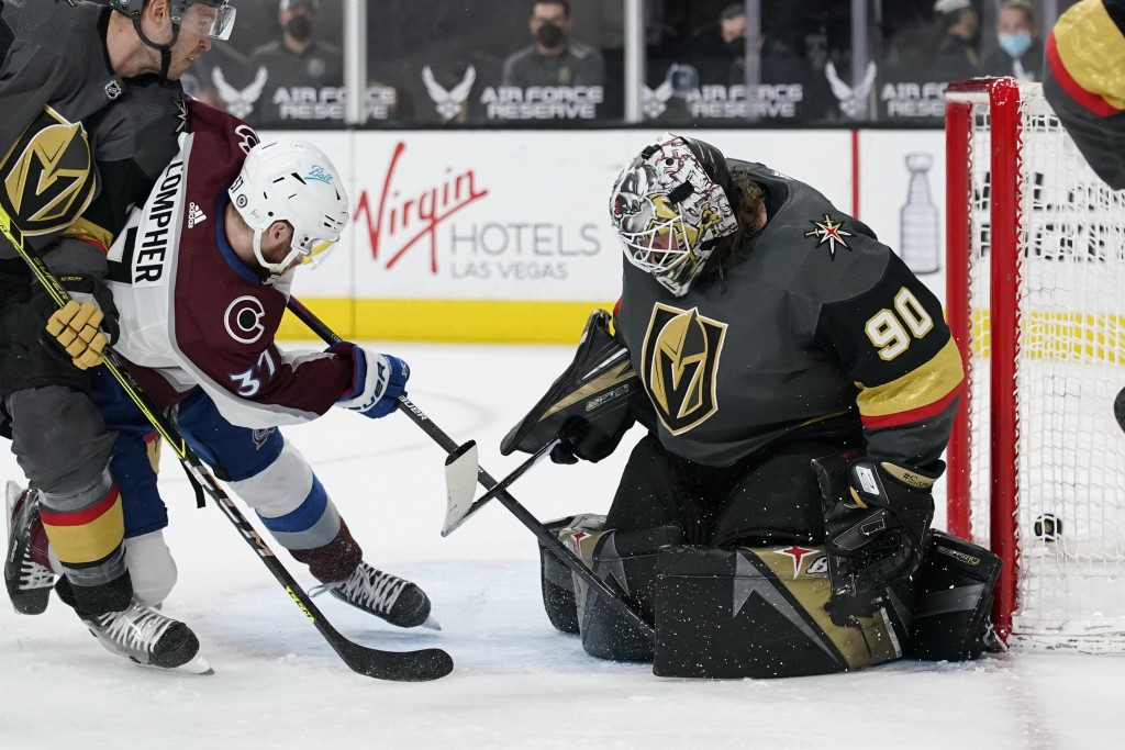 Colorado Avalanche left wing J.T. Compher (37) scores a goal against Vegas Golden Knights goaltender Robin Lehner (90) during the third period of an N...