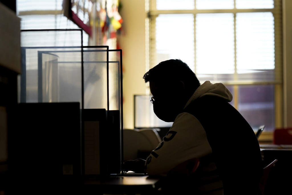 Senior Jose Solano-Hernandez takes a test on the first day of in-person learning at Wyandotte High School in Kansas City, Kan., Wednesday, March 30, 2...