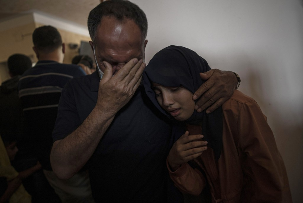 Relatives of 11-year-old Hussain Hamad, who was killed by an explosion during the ongoing conflict between Israel and Hamas, react during his funeral ...