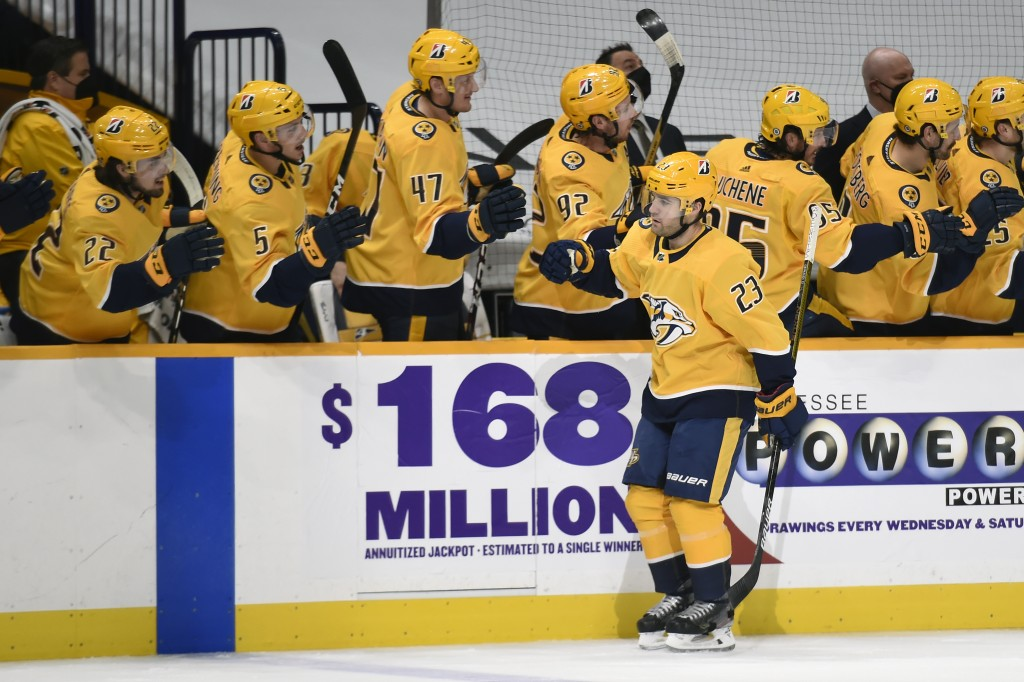Nashville Predators right wing Rocco Grimaldi (23) is congratulated after scoring a goal against the Carolina Hurricanes during the first period of an...