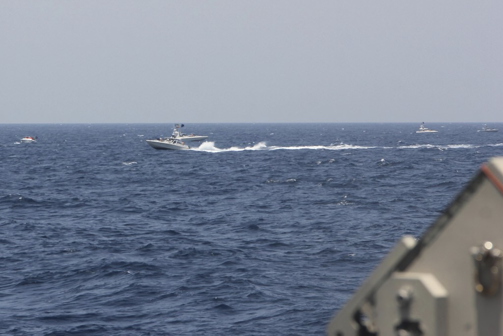 In this image provided by the U.S. Navy, an Iranian Islamic Revolutionary Guard Corps Navy (IRGCN) fast in-shore attack craft (FIAC), a type of speedb...