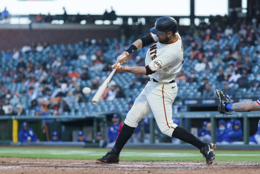 San Francisco Giants' Brandon Belt hits a solo home run against the Texas Rangers during the fourth inning of a baseball game in San Francisco, Monday...