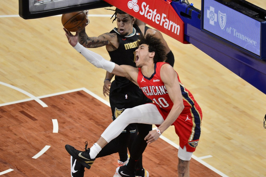 Memphis Grizzlies forward Brandon Clarke blocks a shot by New Orleans Pelicans center Jaxson Hayes (10) in the second half of an NBA basketball game M...