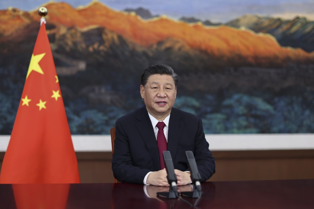 FILE - In this April 20, 2021 file photo released by Xinhua News Agency, Chinese President Xi Jinping delivers a keynote speech via video for the open...