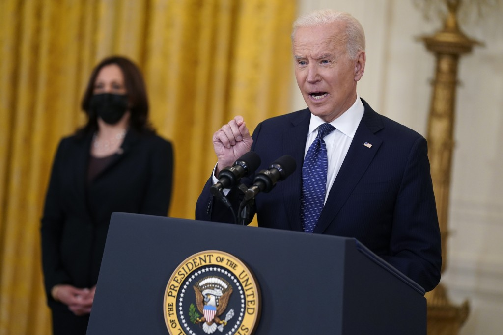 Vice President Kamala Harris listens as President Joe Biden speaks about the economy, in the East Room of the White House, Monday, May 10, 2021, in Wa...