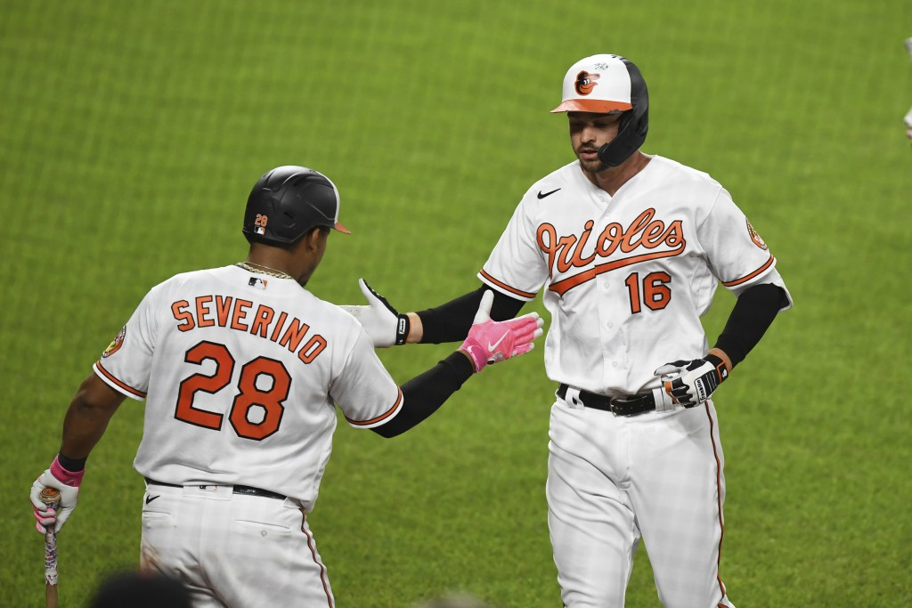 Baltimore Orioles Trey Mancini (16) is greeted by Pedro Severino (28) after hitting sixth inning solo home run during a baseball game Monday, May 10, ...