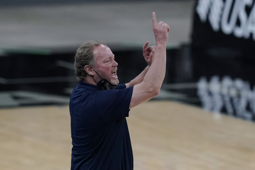 Milwaukee Bucks head coach Mike Budenholzer signals to his players during the second half of an NBA basketball game against the San Antonio Spurs in S...