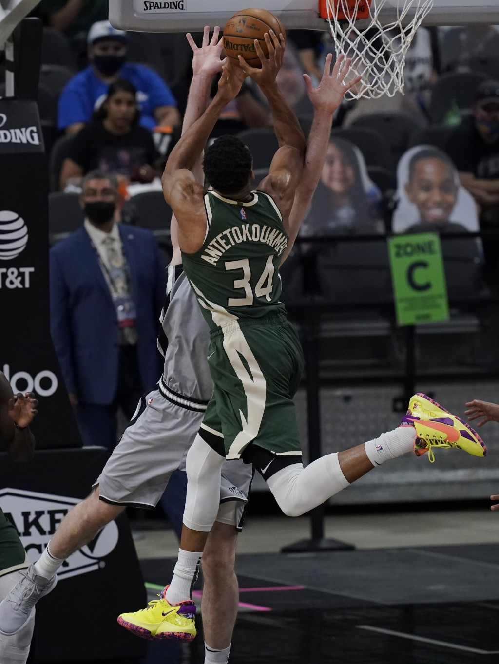 Milwaukee Bucks forward Giannis Antetokounmpo (34) is blocked as he tries to score against San Antonio Spurs center Jakob Poeltl during the second hal...