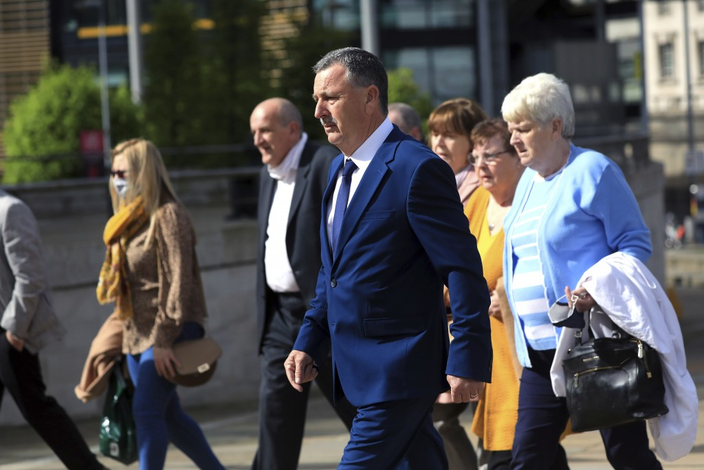 Son John Taggart and other family members of Daniel who was shot, arrive for the inquest into the Ballymurphy shooting, in Belfast, Northern Ireland, ...