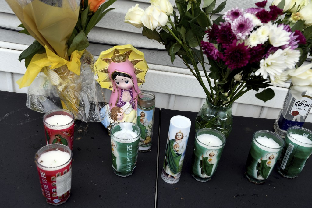 A memorial is seen on Monday, May 10, 2021, outside a mobile home in Colorado Springs, Colo., where a shooting at a party took place a day earlier tha...