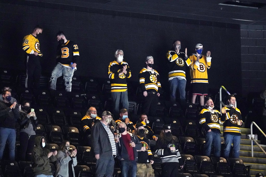 Fans cheer during the second period of an NHL hockey game between the Boston Bruins and the New York Islanders at TD Garden, Monday, May 10, 2021, in ...