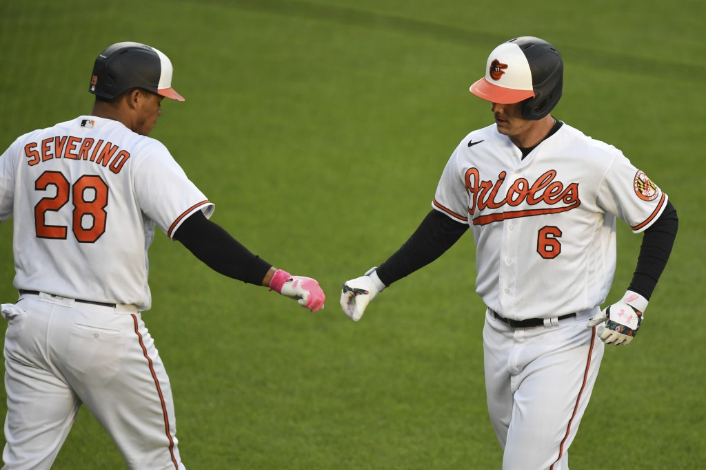 Baltimore Orioles' Ryan Mountcastle (6) celebrates his first-inning home run with Pedro Severino (28) during a baseball game against the Boston Red So...