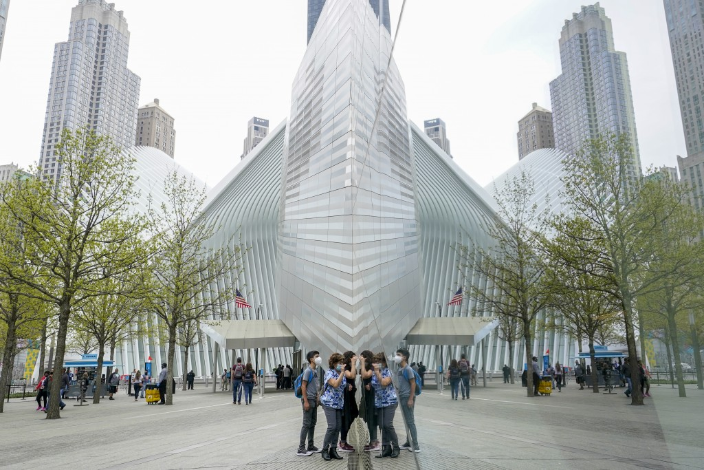 Visitors peek into the museum at the 9/11 Museum & Memorial, Thursday, April 29, 2021, in New York. In recent weeks, tourism indicators for New York C...