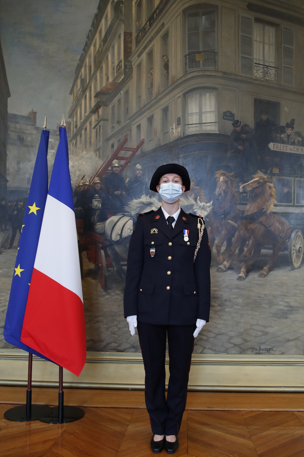 French math teacher-volunteer fighter, Marion Dehecq, poses after she receives a bronze medal for courage and dedication as she used CPR to save the l...