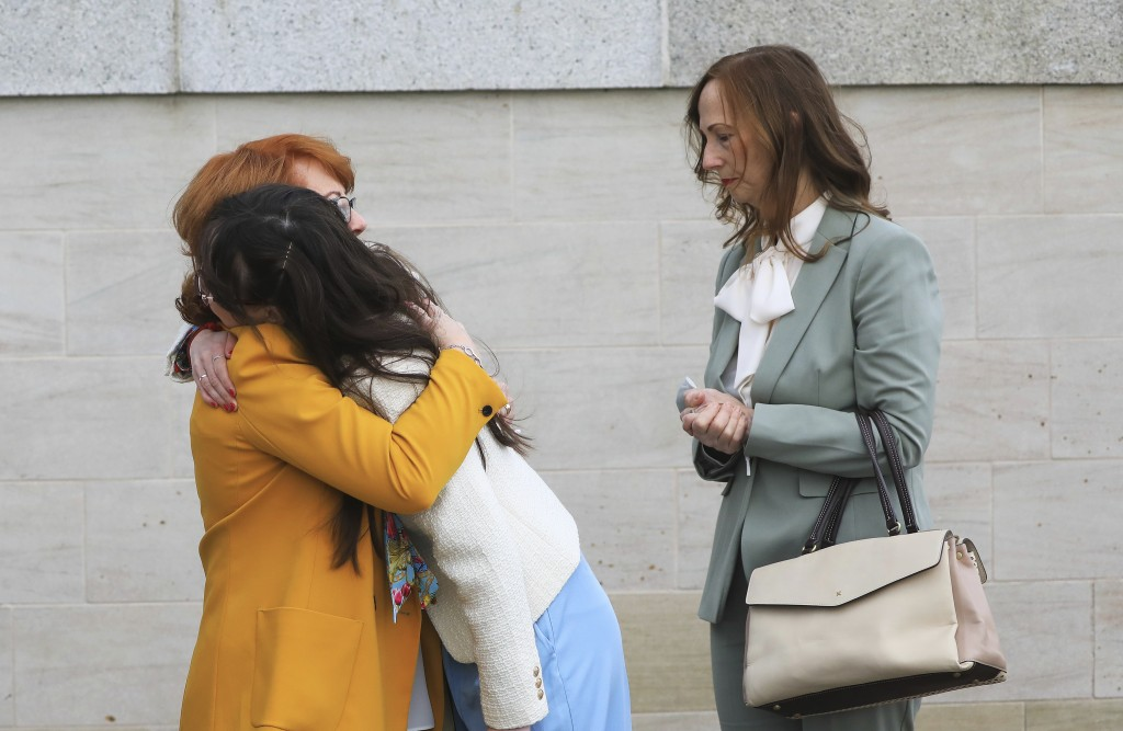 Rita Bonner, left, sister of John Laverty who was shot, with relatives arrive for the inquest into the Ballymurphy shooting, in Belfast, Northern Irel...