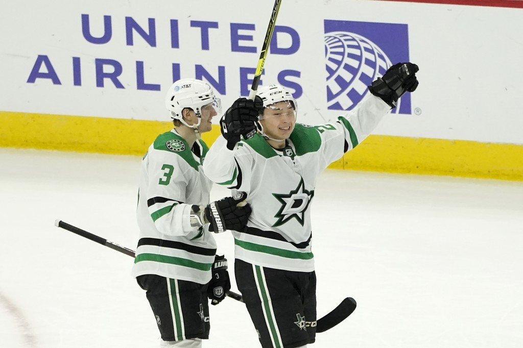 Dallas Stars' Jason Robertson, right, celebrates his game winning goal with John Klingberg during the overtime period of an NHL hockey game against th...