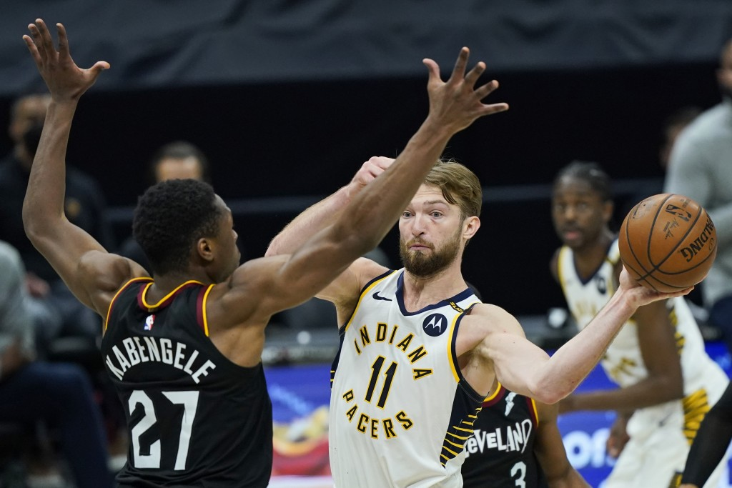 Indiana Pacers' Domantas Sabonis (11) passes around Cleveland Cavaliers' Mfiondu Kabengele (27) in the second half of an NBA basketball game, Monday, ...