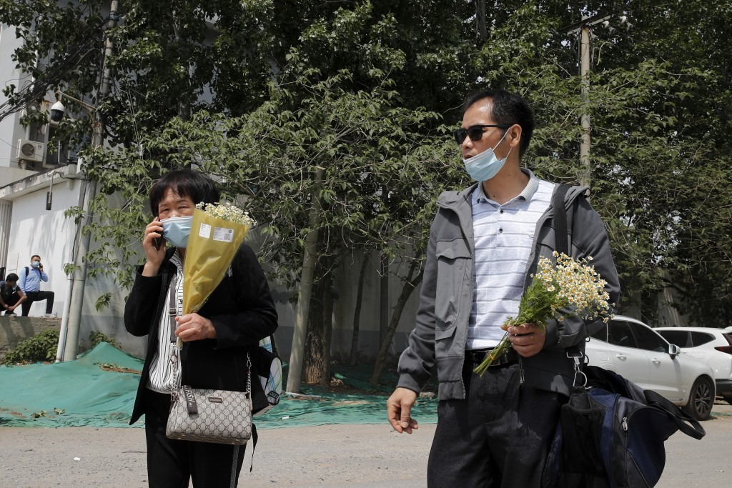 Wei Xiuwen, left, mother of Chen Mei, and Cai Jianli, father of Cai Wei, leave a courthouse after attending their children's court cases in Beijing, T...