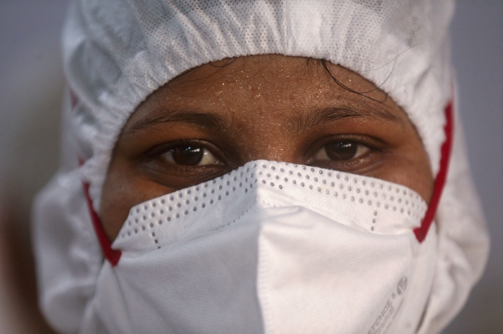 A nurse poses for a photograph inside a ward at the BKC jumbo field hospital, one of the largest COVID-19 facilities in Mumbai, India, Friday, May 7, ...