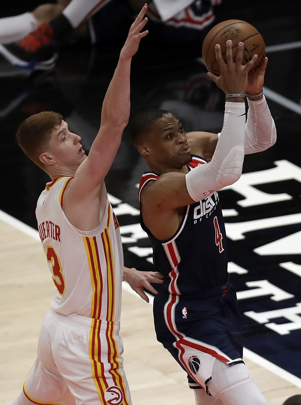 Washington Wizards' Russell Westbrook shoots past Atlanta Hawks' Kevin Huerter (3) during the first half of an NBA basketball game Monday, May 10, 202...