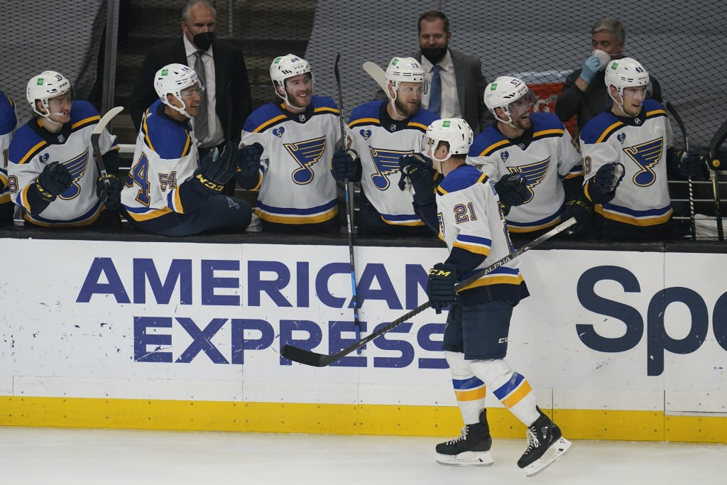 St. Louis Blues center Tyler Bozak (21) celebrates with teammates after scoring a goal during the third period of a hockey game against the Los Angele...