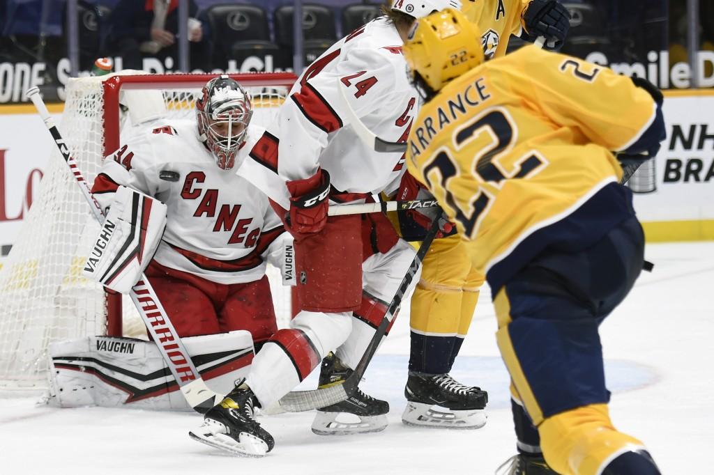 Carolina Hurricanes goaltender Petr Mrazek (34) blocks a shot by Nashville Predators defenseman David Farrance (22) during the second period of an NHL...