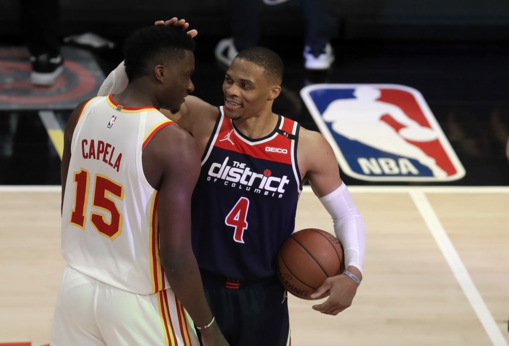 Washington Wizards' Russell Westbrook (4) is congratulated by Atlanta Hawks' Clint Capela at the end of an NBA basketball game Monday, May 10, 2021, i...