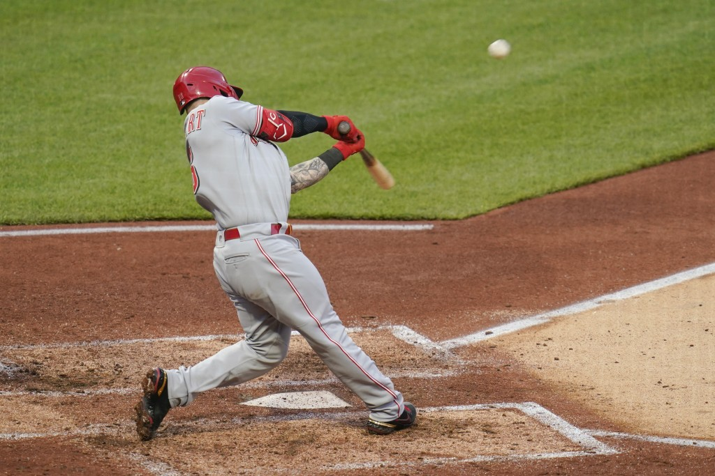 Cincinnati Reds' Tucker Barnhart hits a double to drive in two runs against the Pittsburgh Pirates in the fourth inning of a baseball game, Monday, Ma...