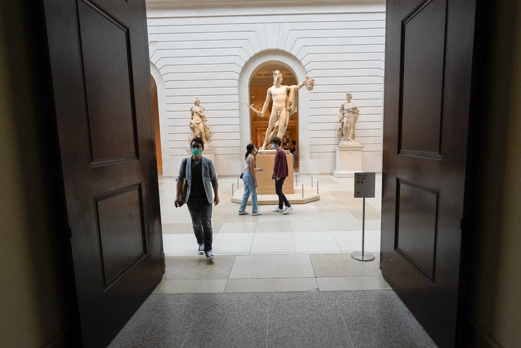 """Visitors to the Metropolitan Museum of Art walk past Antonio Canova's """"Perseus with the Head of Medusa,"""" Thursday, April 29, 2021, in New York. In rec..."""