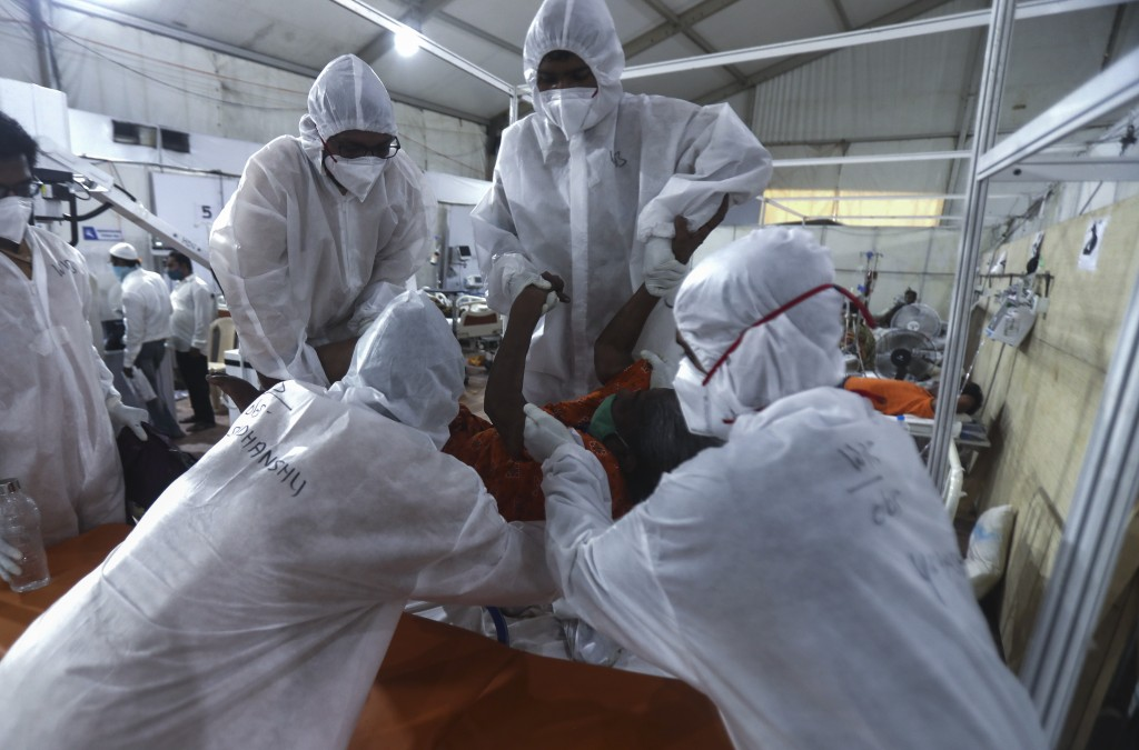 Health workers attend to a patient at the BKC jumbo field hospital, one of the largest COVID-19 facilities in Mumbai, India, Thursday, May 6, 2021.(AP...