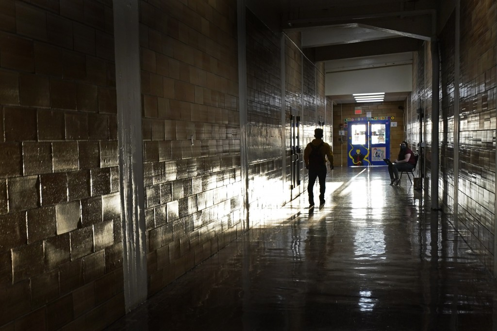 A student walks between classes at Wyandotte High School in Kansas City, Kan., on the first day of in-person learning Wednesday, March 30, 2021. The s...