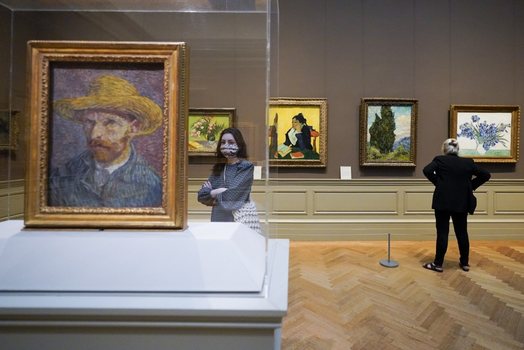 Visitors to the Metropolitan Museum of Art inspect Van Gogh paintings, Thursday, April 29, 2021, in New York. In recent weeks, tourism indicators for ...