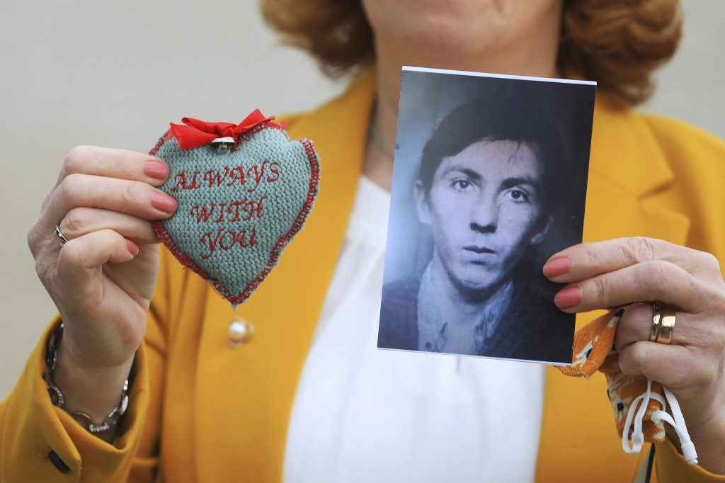 Rita Bonner holds a photograph of her brother John Laverty who was shot in Ballymurphy, ahead of the inquest into the shooting, in Belfast, Northern I...
