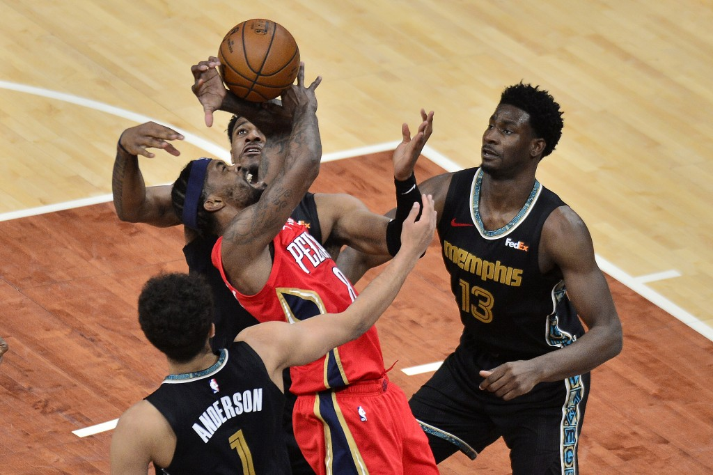 New Orleans Pelicans forward Naji Marshall (8) struggles for control of the ball between Memphis Grizzlies forwards Jaren Jackson Jr., (13), Kyle Ande...