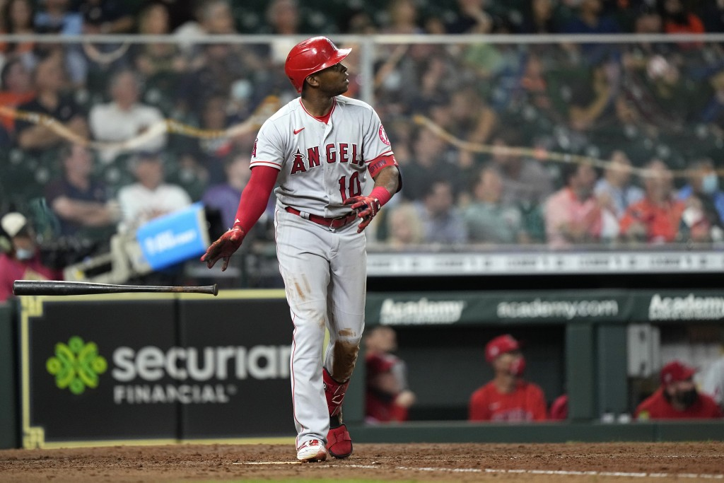 Los Angeles Angels' Justin Upton watches his home run against the Houston Astros during the sixth inning of a baseball game Monday, May 10, 2021, in H...