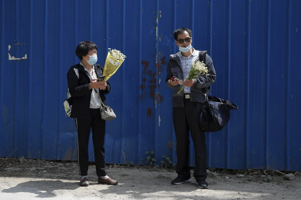 Wei Xiuwen, left, mother of Chen Mei, chats with Cai Jianli, father of Cai Wei outside a courthouse after attending their children's court cases in Be...