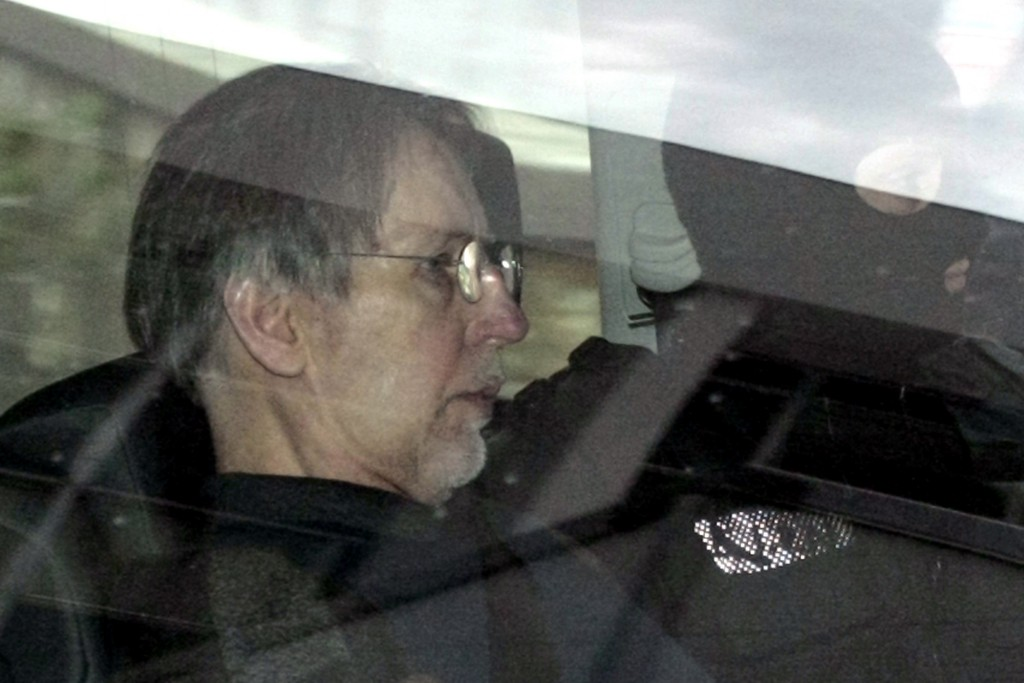 FILE - In this May, 14, 2008 file photo, Michel Fourniret is driven back under heavy police protection to the Charleville-Mezieres courthouse, norther...