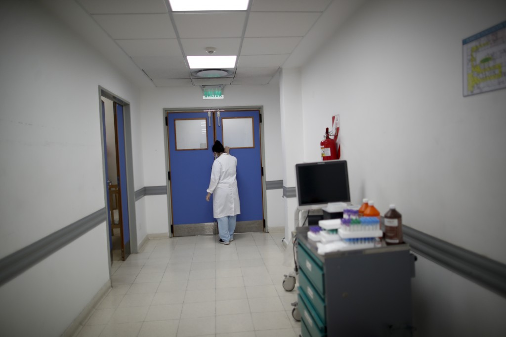 Dr. Veronica Verdino approaches the door to tell the son of a COVID-19 patient that his father died at Llavallol Dr. Norberto Raúl Piacentini Hospital...