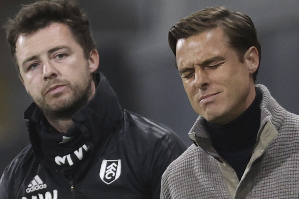 Fulham's manager Scott Parker, right, reacts during the English Premier League soccer match between Fulham and Burnley at the Craven Cottage Stadium i...
