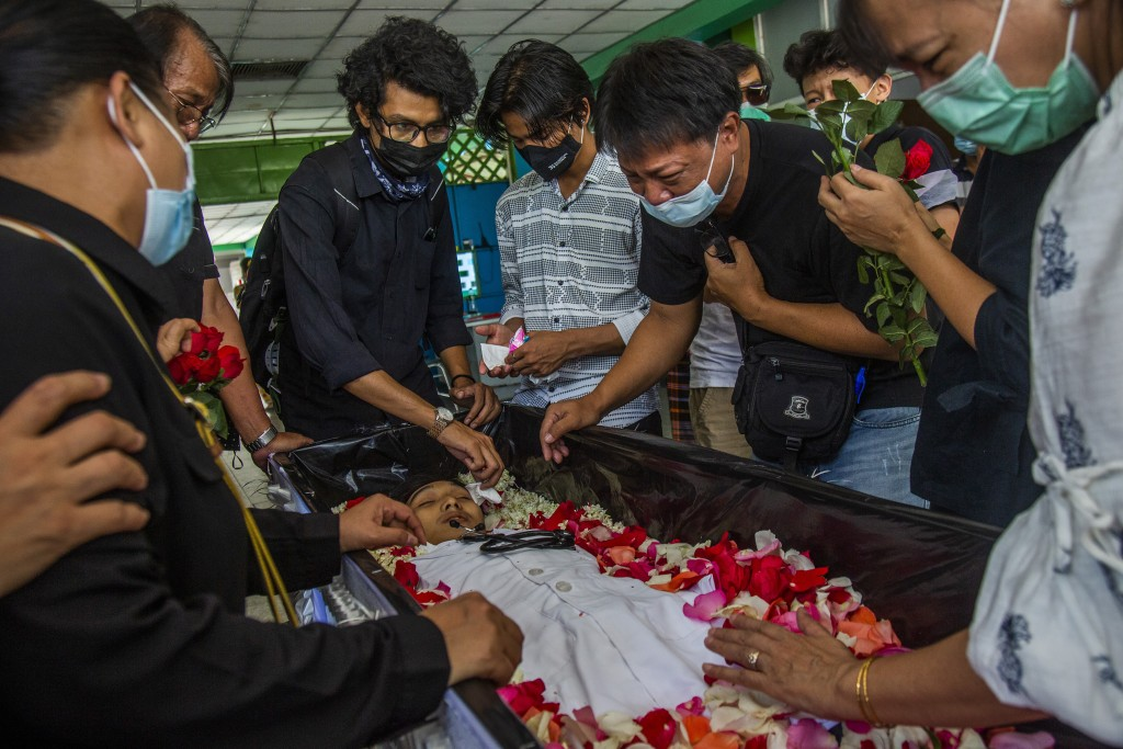 FILE - In this March 16, 2021, file photo, a man weeps at the funeral of Khant Ngar Hein in Yangon, Myanmar, who was shot in the chest during a protes...