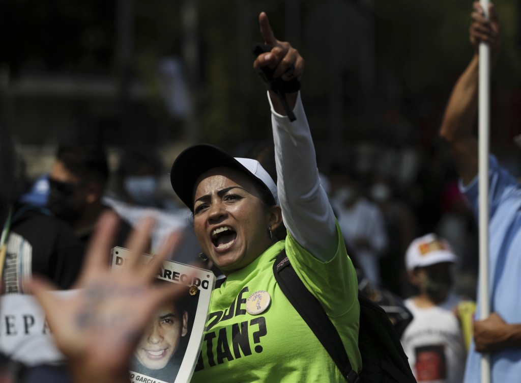 """A person shouts """"Where are our children?"""" during a march in remembrance of those who have disappeared, on Mother's Day in Mexico City, Monday, May 10,..."""